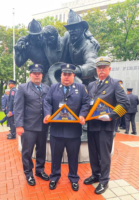 Firefighter Tom Murphy, Pleasant Valley Fire Company # 1 President Andrew Murphy and Past Chief Rich Berger proudly accepted the flags in memory of our two deceased members.