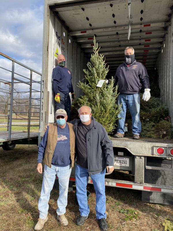"Final tree being loaded in memory of Tom ""Tagger"" Wagner who was a big supporter every year."